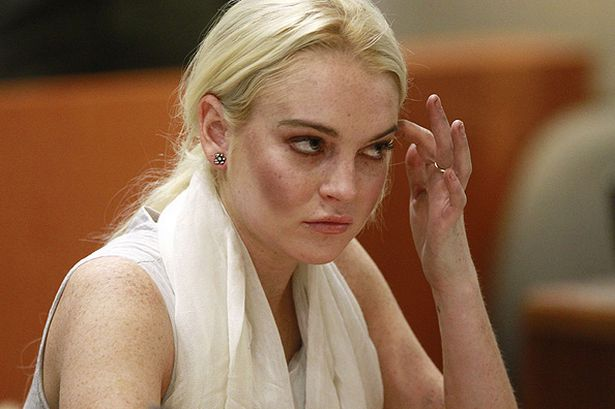 lindsay-lohan-attends-her-progress-hearing-at-the-airport-branch-courthouse-in-los-angeles-pic-pa-398381151